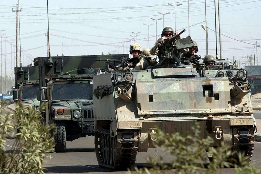 military armored vehicles driving on road