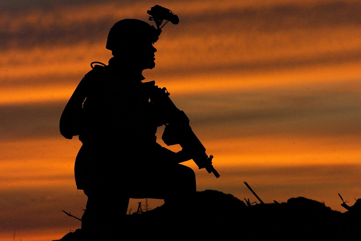 military soldier with equipment at night