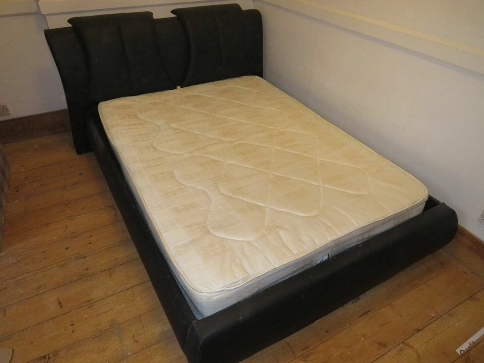 king bed with leather headboard