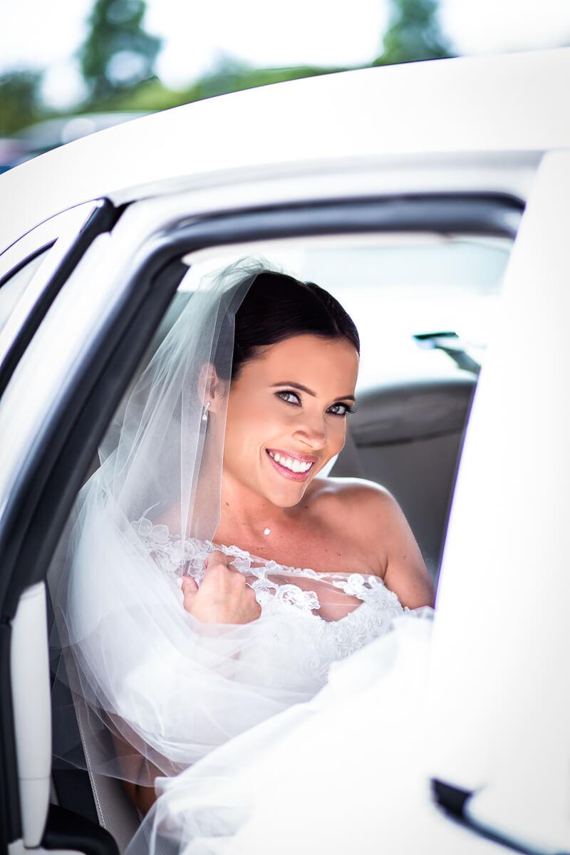 Wedding car bride pose