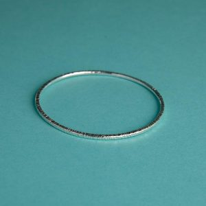Handmade Silver Hammered Bangle with Bark Effect by Corzo & Wood