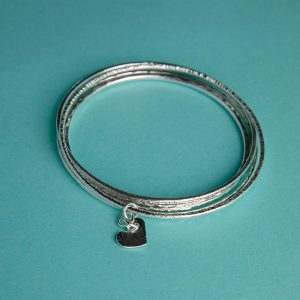 Handmade Silver Trio of Hammered Bangles with Hammered Heart Charm