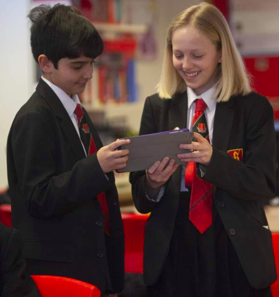 Students viewing work on tablet