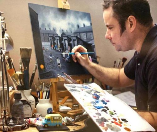 Leigh Lambert painting in the studio