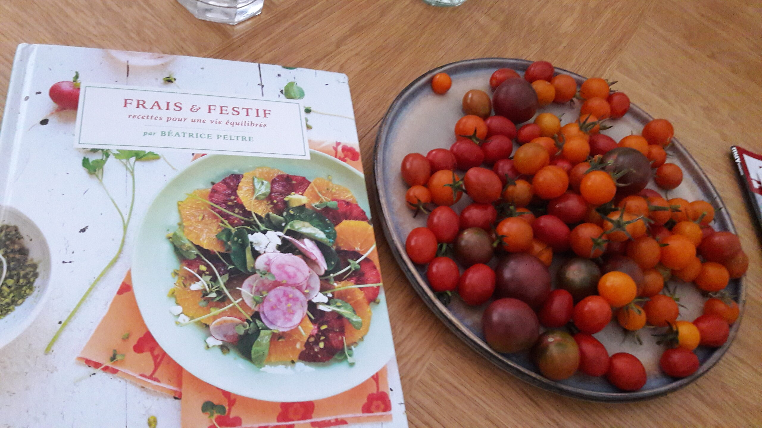 My French Family Table cookbook and a plate of cherry tomatoes for tomato tatin