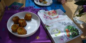 My French Family Table and a plate of cannelés | Cookbook translation services