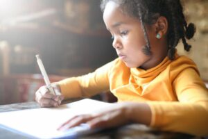 Black girl studying | Education and training translation services
