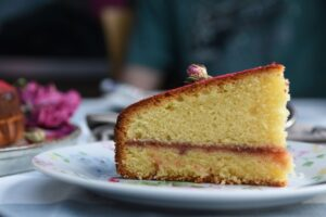 A slice of my homemade Victoria sandwich cake and of my amateur food photography | Specialised culinary translations to tantalise taste buds