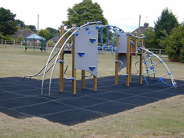 outdoor play area with climbing equipment