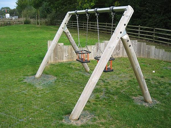 natural wooden swing set