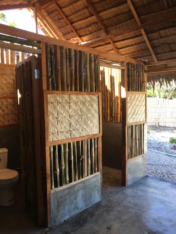 native and tropical restroom or shower room of Booking's best hostel in Siquijor - Love Shack Hostel in siquijor