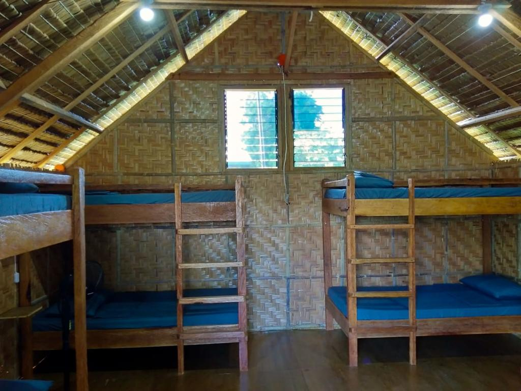 bunk beds in a native hut at See-kee-hor cafe and hostel siquijor