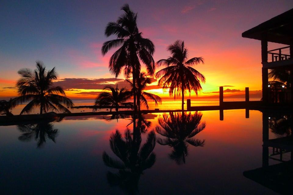 sunset at the poolside of Tugun Beach House in siquijor