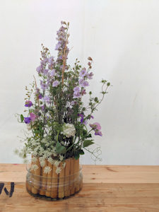 floral arrangement with natural bamboo mechanics. Set in a glass bowl.