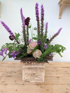 Flower arrangement using sticks for mechanics.