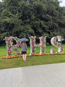 RHS logo, covered in flowers, at the entrance to Tatton Park.