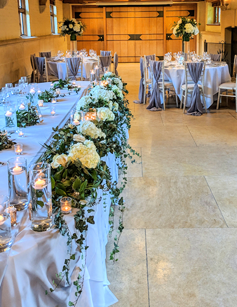 Top Table and Centrepieces in the Wedding Ceremony Room.