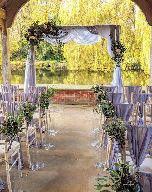 Floral Wedding Arch with Drapes.