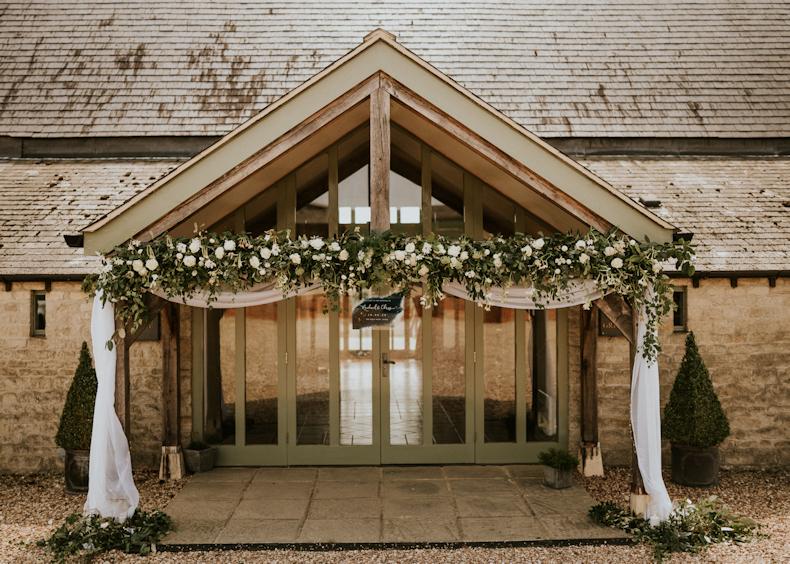 Floral entrance to wedding venue