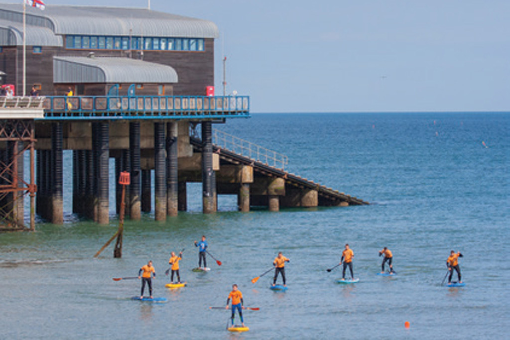 SUP Lessons Paddle-Boards-near-pier