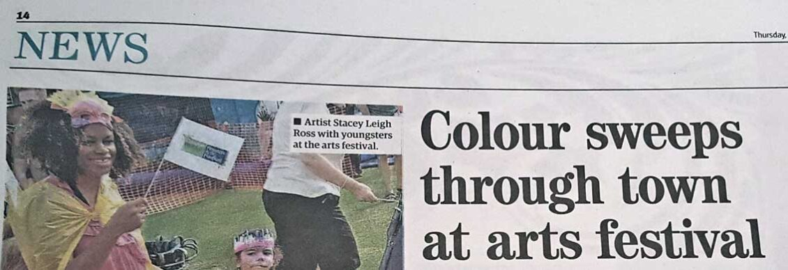 Headline for Royston Crow article about Royston Arts Festival Carnival-like parade showing image of by Leigh artist, Stacey Leigh Ross who held carnival craft workshops for the Royston Museum