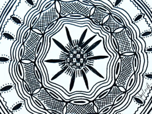 Cropped intricate circular pattern almost like a henna tattoo or mandala but of African design influence.