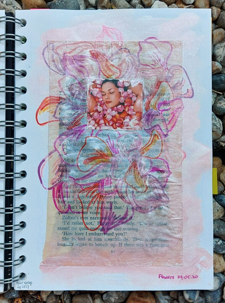 sketchbook collage, ink & sharpies piece showing lots of soft coloured flower petals around the image of a woman's face which is buried among flower petals in a bath