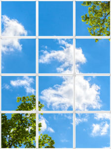 Decorative faux window for ceiling with clouds and trees
