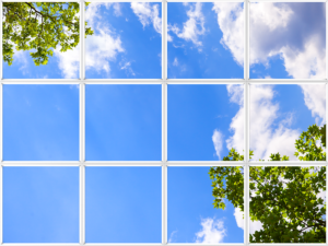 Artificial sunlight created by faux window with green foliage and big clouds