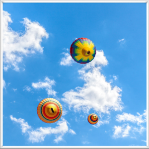 Colourful hot air balloons in a static sky scene