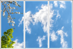 Faux skylight ceiling with blue sky, white clouds, green leaves and pink blossom