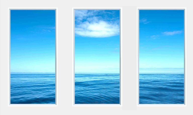 3 panel landscape window with still blue sea