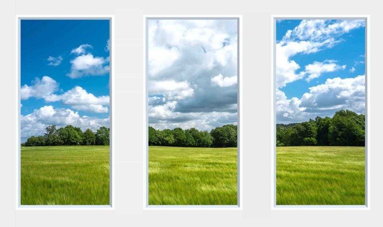 3 panel landscape window with green field and trees