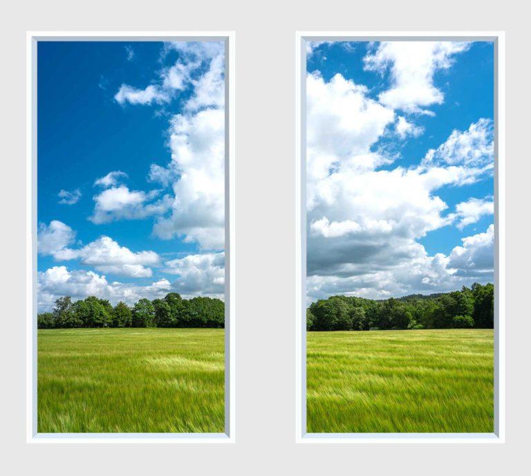 2 panel landscape window with green field under blue sky