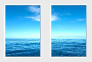 2 panel landscape window with still blue sea