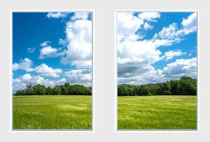 2 panel landscape window with green field under cloudy blue sky