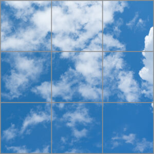 Artificial skylight for uk with nine panels in a square showing blue skies and white clouds