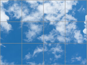 Twelve sky ceiling light panels in large rectangle with blue sky and cloud scene