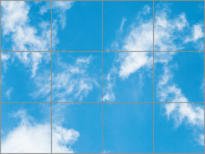 Twelve sky ceiling light panels in large rectangle with light blue sky and wispy cloud scene