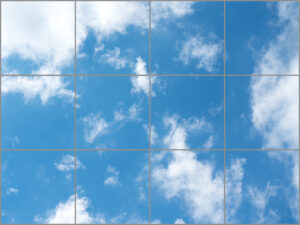 Twelve sky ceiling light panels in large rectangle with soft blue sky and cloud scene