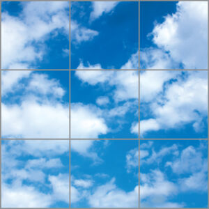 Artificial skylight for uk with nine panels in a square showing bright blue sky and white cloud scene