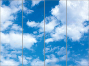 Twelve sky ceiling light panels in large rectangle with bright blue sky and white clouds scene