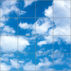 Sixteen sky ceiling light panels in large square with bright blue sky and cloud scene
