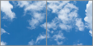 Two cloud sky panels for ceiling with blue skies and wispy clouds