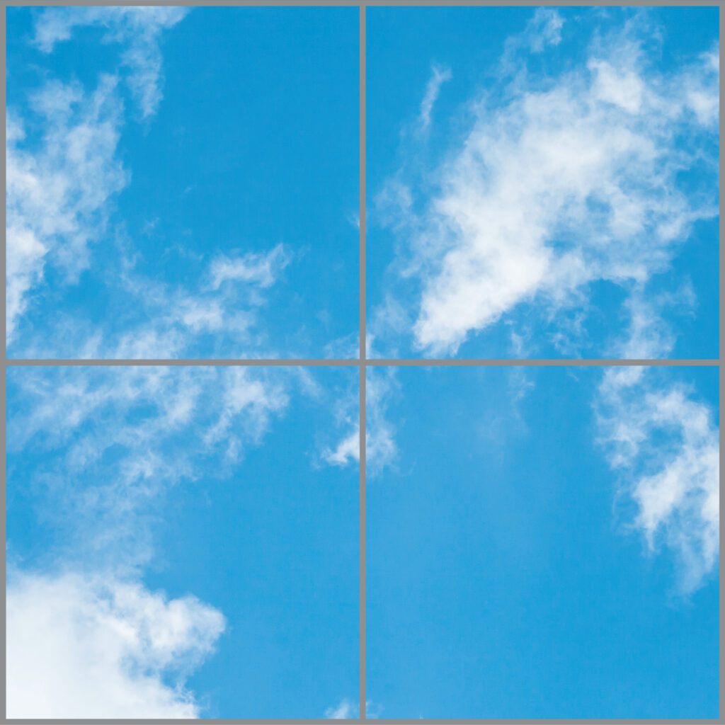 Four cloud scene led panels in a square with light blue skies and wispy clouds