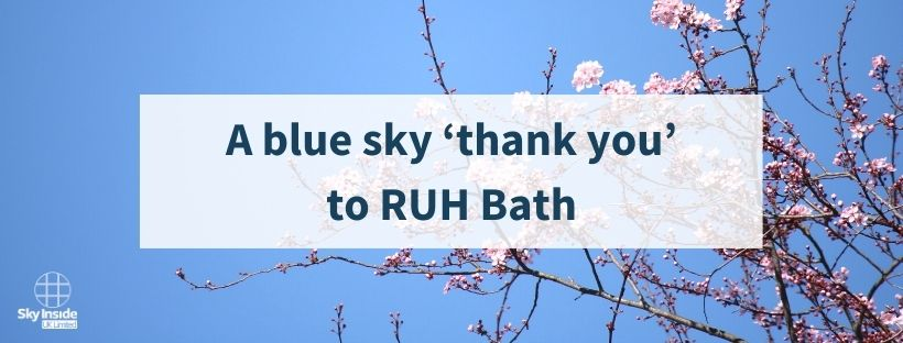 Blog banner with text 'A blue sky thank you to RUH Bath' in front of image of blue sky and twigs with a few pink blossoms