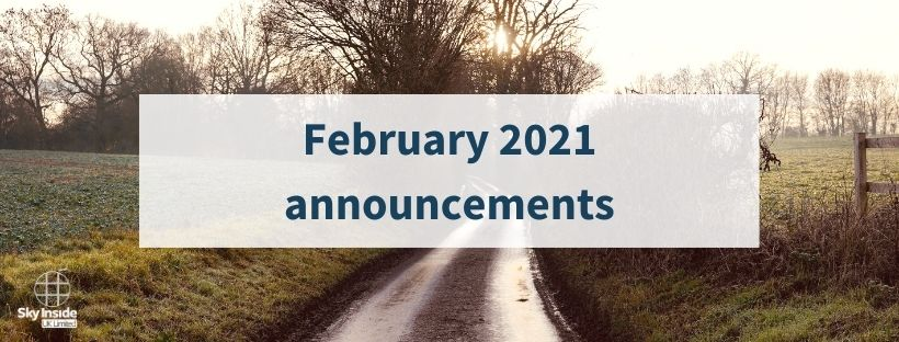 Blog banner with text 'February 2021 announcements' with background image of a country road in the middle of two fields surrounded by winter trees and a dim winter sun shining