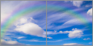 Kids 2-panel window with blue sky view with clouds and faint rainbow