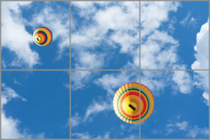 6-panel window with blue skies, white clouds and two colourful hot air balloons
