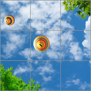 9-panel window with blue skies, white clouds, hot air balloons and green leaves